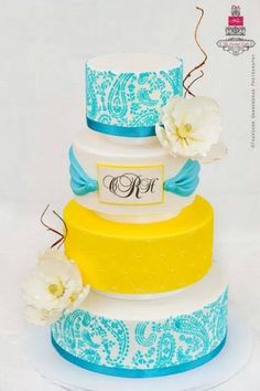 ..white, blue and one bright yellow wedding cake