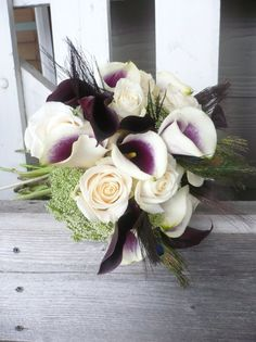 Striking purple and white calla lilies add drama to this white rose bridal bouquet.  #purplewhite #callalily #bouquet