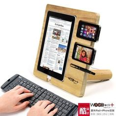 """woodDock is a wooden dock for """"i"""" devices, you can place iPad, iPhone, iPod together and turn them into a station of entertainment, work and charging . woodDock is a product available at mygeek Tech Gadgets, Cool Gadgets, Tech Hacks, Technology Gadgets, Wood Projects, Woodworking Projects, Woodworking Skills, Furniture Projects, Furniture Plans"""