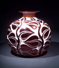 """R. LALIQUE Vase, """"Sophora,"""" c. 1926, in deep amber glass with whitish patina. Engraved R. Lalique France"""