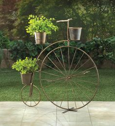 "Vintage charm is in bloom! This adorable planter's frame looks like a high-wheel bicycle from bygone days, with one large wheel in the front and a smaller wheel in back. Attached are three pails that are ready to hold your blooming plants. This lovely accessory will look great on your patio or in your favorite room.  Item weight: 5.4 lbs. 32"" x 10"" x 33¾"" high. Iron. Plants not included.  Some Assembly Required.     Check out our Etsy shop!"