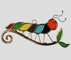 rups. Stained glass . I think this would make an adorable brooch.