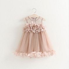 We LOVE this sleeveless petal party dress and we think your baby girl will too. Light breathable fabric for the ultimate comfort factor, adorable sheer tank top style sleeves, petal-like top with flow