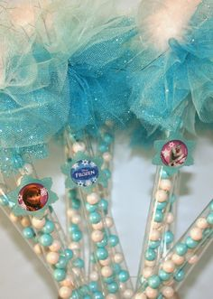 Frozen party favors wands filled with Sixlets chocolate candies and decorated with Disney Frozen rings.  The kids loved them!