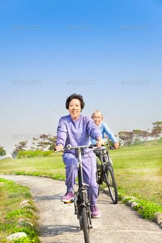 asian seniors couple biking in the park ...  asian, background, bicycle, bike, chinese, cloud, countryside, couple, cycle, cycling, cyclist, elderly, enjoying, exercise, family, female, fit, fitness, fun, grandfather, grandmother, gray, happy, healthy, leisure, lifestyle, male, man, mature, old, older, outdoors, outside, park, pensioner, people, person, pleasure, portrait, recreation, relaxed, retirement, ride, senior, sky, smiling, sport, together, woman, workout