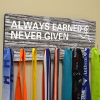 "Hook those hard-earned race medals onto our unique display features a high quality wood board that is professionally printed with our exclusive Hooked On Medals Hanger design. Board measures 15 3/4"" x 6 1/4"" and has 9 hooks."
