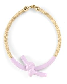 "A pastel, glossy enameled knot makes a sherbet-hued centerpiece. Finished in tan rope and gleaming goldtone hardware, this must-have necklace from Orly Genger by Jaclyn Mayer makes a nautical, feminine statement for spring.      -  Enamel on rope    -  16"" long"