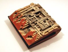 Carved books by Brian Dettmer