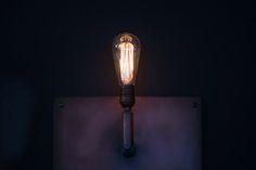 Dark walls and Edison lightbulb fixtures. http://bdantiques.com/