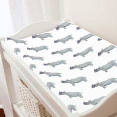 "Change Pad Cover in and Painted Rhino by Carousel Designs.  Keep your baby comfortable and dry with this changing pad cover, designed to fit most contoured changing pads. Machine washable for easy clean-up. Fits standard contoured changing pads approximately 16"" x 32""."