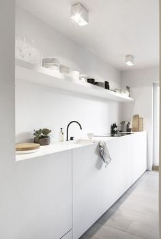 White minimal kitchen with black tap