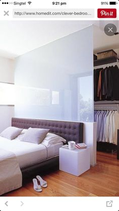 Walk in wardrobe behind bed More
