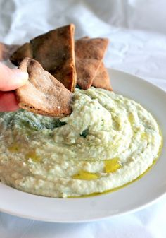Garlic White Bean Basil Hummus with Homemade Toasted Pita Chips via ambitiouskitchen.com