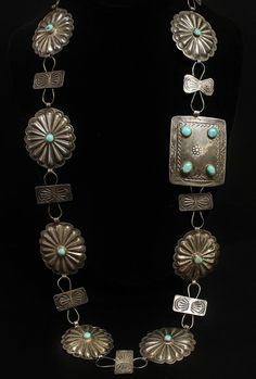 Navajo Conch Belt Sterling & Turquoise Stamp Work 34.25 Long (13) Turquoise Cabochons Offered here is a fantastical Navajo made sterling silver & blue