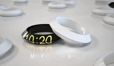 Mini Projector Bangle: This unique concept by Prospective Design Studio features a powerful high definition projector and USB data storage, that allows it to project presentations directly on to any surface