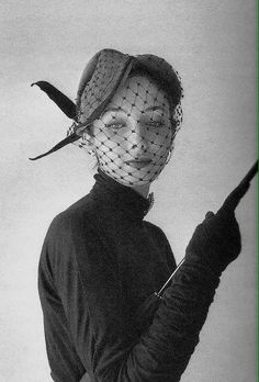 1951 pillbox hat with veil and feathers. Designed by Jaques Fath and photographed by Willy Maywaldd ~ FF03-04-2016