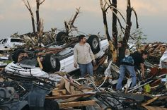Residents begin digging through the rubble of their home. (AP Photo/Mike Gullett) Joplin Tornado May 22, 2011