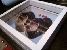 ikea frame to display first shoes. brilliant idea instead of hiding them somewhere away