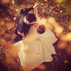 Love this angle...the photographer must have had to climb a tree to get this shot...great fall wedding idea.