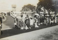 King George V and Queen Mary at the Delhi Durbar in 1911 commemorate their coronation as Emperor and Empress of India in a parade wearing ornate dresswear