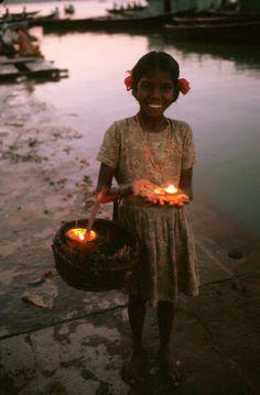 "unearthedviews: "" INDIA, Benares/Varanasi: young girl with offer at the Gange. © Ferdinando Scianna/Magnum Photos """