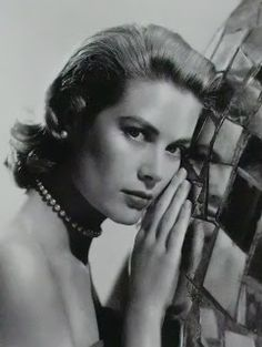 A postcard of Grace Kelly, before she married Prince Rainier III of Monaco.Marie Poutine's Jewels & Royals