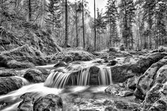 A long exposure image showing the flow of water in Hallstatt Austria. Hallstatt, Black And White Artwork, Image Shows, Prints For Sale, Small Towns, Black And White Photography, Austria, Travel Photography, Waterfall