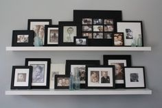 I'm always looking for ways to organize picture frames - love this orderly but varied look
