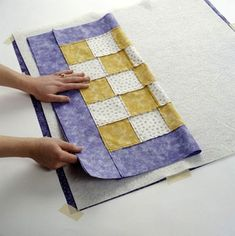 Layering the quilt top, batting, and backing before quilting is an important  step in preparing your project for quilting.