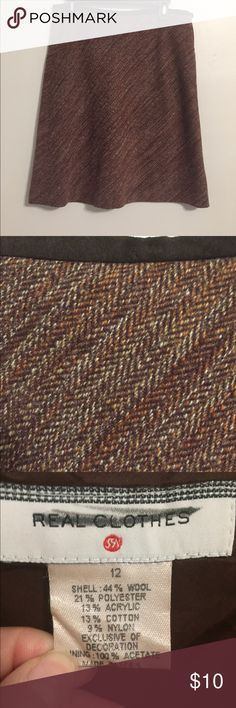 Vintage Saks Fifth Avenue Real Clothes Wool Skirt This is a vintage wool skirt from the Real Clothes line at Saks Fifth Avenue. Lined. A-line style. Tweed pattern. Runs about a size small in my opinion. Saks Fifth Avenue Skirts A-Line or Full