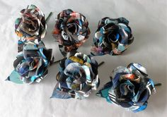 Hey, I found this really awesome Etsy listing at https://www.etsy.com/listing/286824745/comic-book-paper-flower-rose-buttonhole