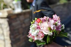 A beautiful bridal bouquet attracts more than admiring looks, a butterfly in flight shown just above the bouquet. This is why I do what I do! Bouquet by Seasonal Celebrations, photo courtesy of Lusa Lai photography.