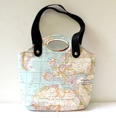 Tote and Handbag - Eco-Friendly World Map Printed Cotton Fabric, Metal Purse Handle, Leather Straps. $63.00, via Etsy.