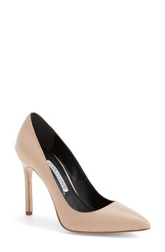 Sleek and sophisticated, this classic single-sole pump is a must-have addition to your footwear collection. A slender heel and low-cut topline maximize the leg-lengthening effect, while a padded footbed ensures comfort.