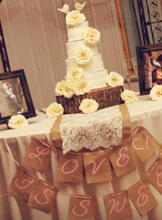 Lace & burlap cake. I want something like this, maybe minus the flowers all over it. I would rather a touch of light green maybe or light coral.