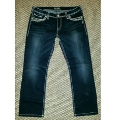 Silver Jeans Brand new never worn Silver Jeans size 33 waist. So aforable, dark was, with bling on the pockets Silver Jeans Jeans Boot Cut