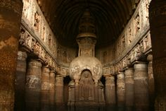 Ajanta Caves are a set of 29 caves carved into the volcanic rock Ajinṭha near Jalgaon in the region of Maharashtra, India. The volcanic rock reef extends throughout the region.