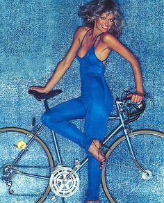 Farah Fawcett with bike.