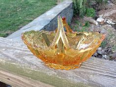 Hey, I found this really awesome Etsy listing at https://www.etsy.com/listing/237657847/vintage-amber-glass-candy-jewelry-dish