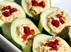 Cucumbers filled with hummus make for a great lunch box snack or quick yet elegant appetizer. Elegant Appetizers, Yummy Appetizers, Yummy Snacks, Appetizer Recipes, Healthy Snacks, Snack Recipes, Healthy Eating, Crowd Recipes, Cafe Recipes