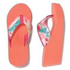"Bright and cheerful floral flip-flops with an added wedge for added height. FEATURES• 2 1/4"" H• Available in…"