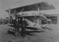 Pale blue Fokker Dr 1 Triplane of 48 kill ace Werner Voss, with his personal mechanics in the foreground.  He was killed flying this aircraft in September 1917 when fighting alone against 8 SE5a fighters of the elite 56 Sqn: he shot holes in all of them.