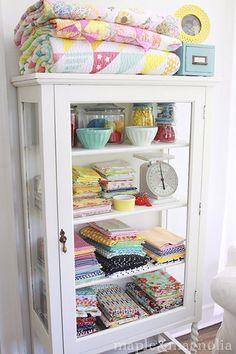 Treat your fabric stash like the art work it is!  Beautiful sewing room organizing.  #olisoeasy