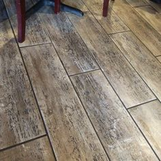 I LOVE this floor!  It's tile that looks like wood.  I bet it wears like iron and is easy to clean