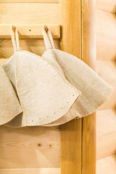 three russian white wool hats for sauna banya bath house on a wooden