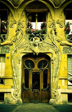 Vibrant yellow carved entrance and carved wood door