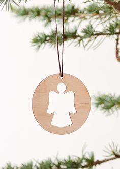 Handmade christmas ornament made as an angel in lacercut veneer. Hight: 6 cm (without suspension), 16 cm (with suspension)