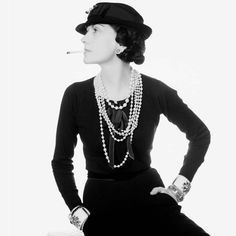 Coco Chanel pictured in one of her most iconic photographs wearing strands of pearls and Maltese cuffs. Discover the history of pearls, the most iridescent and sought after gemstones of all time: http://www.thejewelleryeditor.com/jewellery/history-of-pearls-pearl-jewellery-rings-earrings-necklaces/ #jewelry
