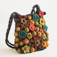 This is a bag for sale not a DYI. It's hand made from the women of Napal. My 22 year old daughter went crazy for it. So, I am going to try to make my own version. Will pin photos after I finish. I'm thinking I'll make for her for Christmas. Flower Bag