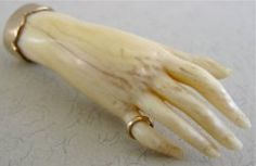 century Ivory carved Hand broach mounted in Gold setting. Likely French.
